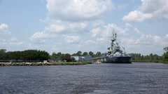 USS North Carolina wide angle seen from across water 4k Stock Footage