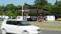 View of the texaco gas station in the suburb - surrounded by trees Stock Footage