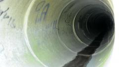 view of the inside pipeline - grafitti on the walls - close up - stock footage