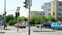 Traffic in the city with crosswalk, semaphore, traffic sign and buildings around Stock Footage