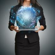 Close up Girl holding a digital globe over tablet - stock photo