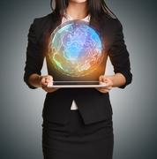 Close up Girl holding a digital globe over tablet Stock Photos