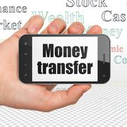 Currency concept: Hand Holding Smartphone with Money Transfer on display Stock Illustration