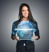 Close up of business woman holding digital globe with search keep in hand - stock photo