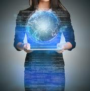 Close up of business woman holding digital globe keep in hand - stock photo