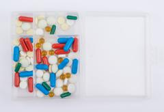 Tablets and capsules for medicines glass box - stock photo