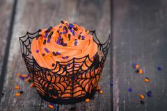 Festive Halloween cupcake - stock photo