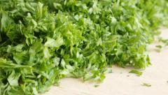 Green vegetable parsley plant cuts on  cutting board  4K 3840X2160 UltraHD   Stock Footage