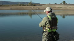 Fisherman catches a fish, almost empty reservoir in the Republic of Crimea. Stock Footage