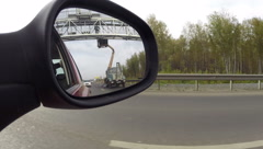 View of the road in the rearview mirror of a car Stock Footage
