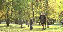 Happy family playing outdoors with autumn leaves 4K Stock Footage