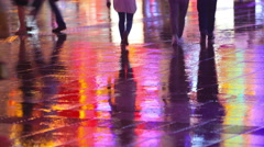 Colorful city lights and  people walking in the wet street - stock footage