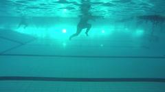 Underwater swim activities with swimmers Stock Footage