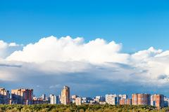 Large low white cloud over residential district Stock Photos