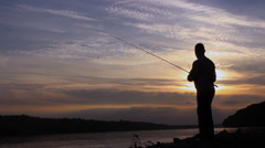 Silhouette of Fisherman on sunset, Fisherman Casting Stock Footage
