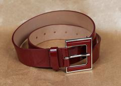 Stock Photo of Shiny dark red patent leather belt accessory