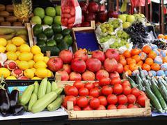 Fresh organic food piles sold on market - stock photo
