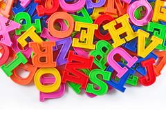Colorful plastic alphabet letters on a white Stock Photos