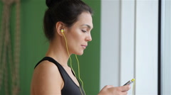 Yoga girl listening to music - stock footage