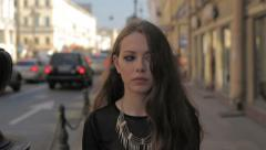 Beautiful sad woman walking in the city (messy mascara on face). Slow motion. Stock Footage