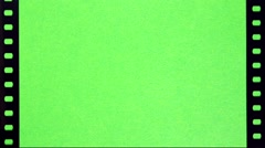 Perforation of Film on Green Screen - stock footage