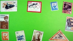 Postage Stamps on a Green Screen Stock Footage