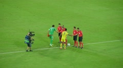 Team captains and referees greet each other. Football. Stock Footage