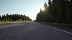 Bumper camera view of driving on a country highway in Finland Stock Footage