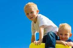 Children kids in playground climbing playing. - stock photo