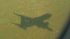 Airplane shadow landing Stock Footage