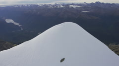 Aerial footage of the snowy peak of Mount Madeline Stock Footage