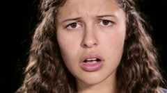 Close up of upset young women looking at camera and raising arms in frustration - stock footage