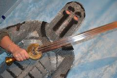 Knightly chain armor and sword - stock photo