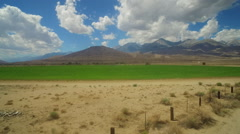 An aerial over farmland in the owens valley region of California with irrigation - stock footage
