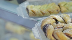 Takes a plait pastry in shelves of bakery (pan shot) Stock Footage