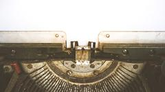 Typewriter and empty white paper , vintage style - stock photo