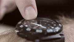 Man's finger tapping his watch. He's late or he's waiting. Stock Footage