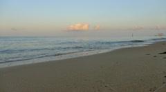 Gentle waves washing ashore on beach Stock Footage