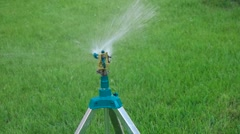 Head of garden sprinkler working copy space on green grass Stock Footage