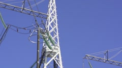 High voltage post or High voltage tower in green field Stock Footage
