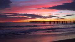 A gorgeous red orange sunset coastline shot along the Central California coast - stock footage