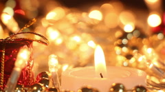candle and christmas lights close-up out of focus - stock footage