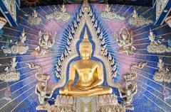 Golden Buddha statue on the altar at Wat Pariwat, Bangkok - stock photo