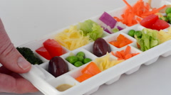 Fresh vegetables served in small portions tray Stock Footage