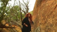Primitive caveman desert rock rocks cave man Stock Footage