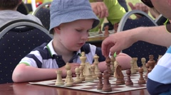 Young clever boy think and move chess figures in free tournament. 4K Stock Footage