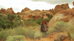 Primitive man outside in desert area Stock Footage
