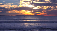 A gorgeous red orange sunset coastline shot along the Central California coast Stock Footage