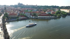 Aerial view of Vltava River with two boats and bridge in Prague Stock Footage