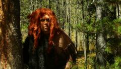 Viking caveman in forest cave man Stock Footage